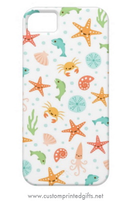 Fun kawaii aquatic sea life pattern with cute cartoon starfish, crabs, fish, seaurchins, seashells and seaweed