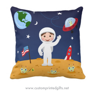 Cute pillow for a boys room or baby nursery featuring a happy little astronauts with his alien friends on planet mars