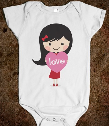 Fun design for baby girls featuring a cute little girl holding a pink heart with white text Love