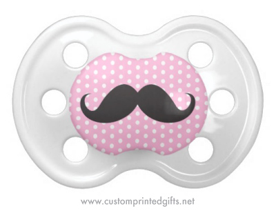 Funny black handlebar mustache on pink polka dots pacifier dummy