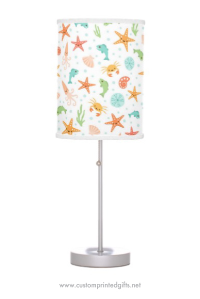Cute lamp for children with kawaii sea life pattern with crabs starfish fish seashells and octopi