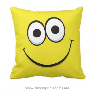 Custom pillow featuring a funny cartoon smiley face on a yellow background