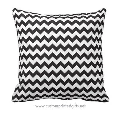 Trendy throw pillow featuring a black and white zig zag pattern